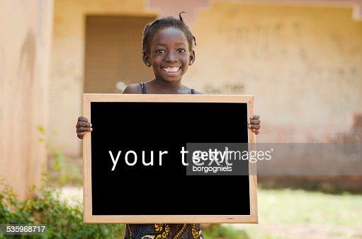 Education Symbol Metaphore: African Ethnicity Girl Holding Blackboard in Mali : Stock Photo