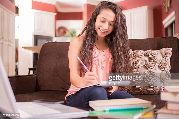 Education.  Teenage girl studying at home. Student. Homework.