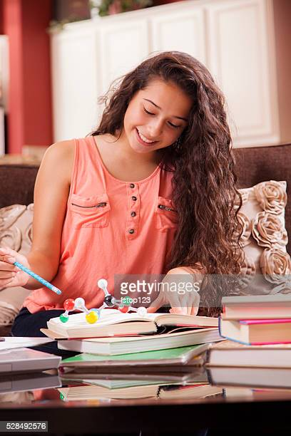 Education.  Teenage girl studying DNA molecule, science at home. Homework.