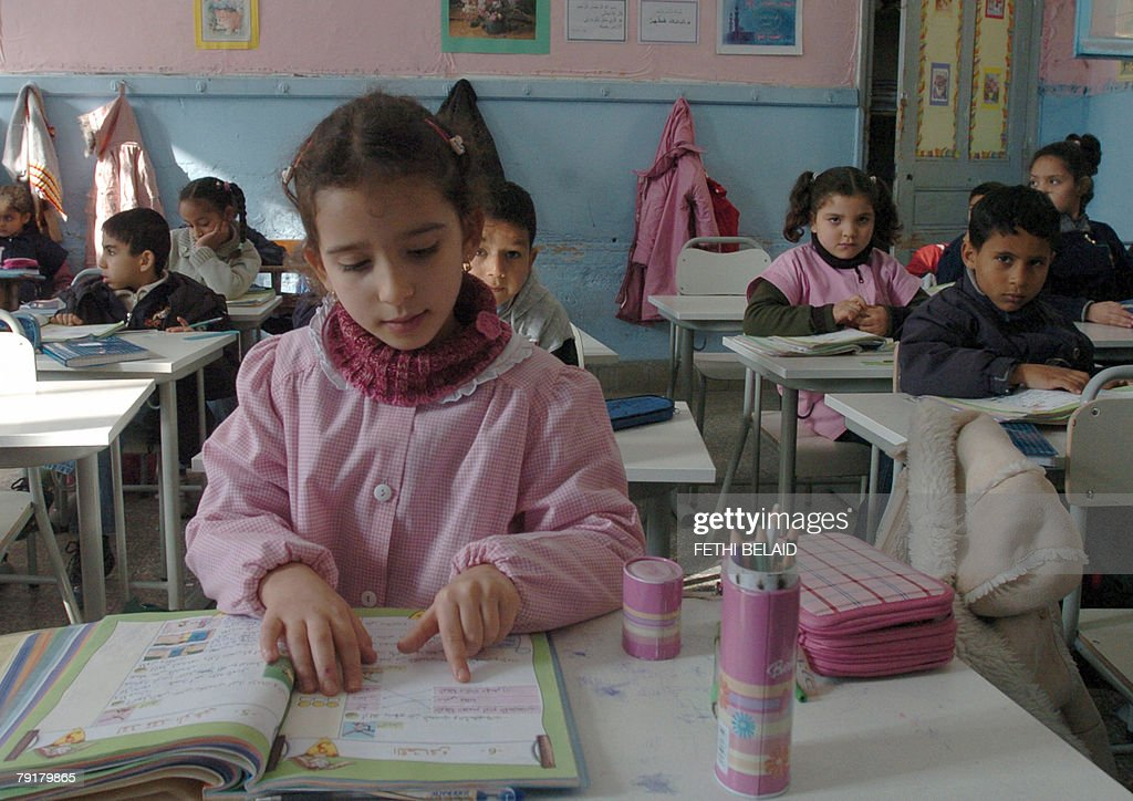 FRENCH 'Education-Maghreb-UN' A young Tunisian student reads her lesson in a classrom of a primary school in Tunis 23 January 2008. According to a UN (United Nations) objective, Tunisia and Algeria should guarantee education for all by the year 2015.