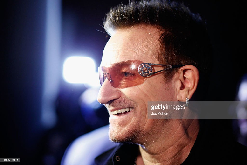 Edun co-founder Bono smiles backstage at the Edun Fall 2013 fashion show during Mercedes-Benz Fashion Week at Skylight West on February 7, 2013 in New York City.