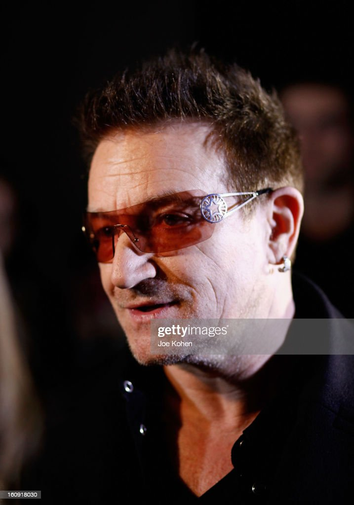 Edun co-founder <a gi-track='captionPersonalityLinkClicked' href=/galleries/search?phrase=Bono+-+Singer&family=editorial&specificpeople=167279 ng-click='$event.stopPropagation()'>Bono</a> stands backstage at the Edun Fall 2013 fashion show during Mercedes-Benz Fashion Week at Skylight West on February 7, 2013 in New York City.