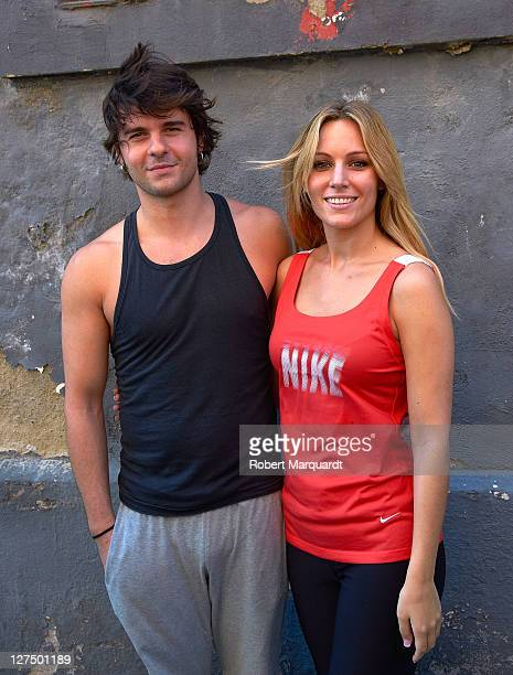 Edurne and Jordi Coll pose during a break in rehearsal for their latest work in the theater play 'Grease' outside the Nou Ivanow studios on September...