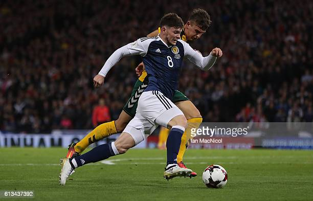 Edvinas Girdvainis of Lithuania vies with Oliver Burke of Scotland during the FIFA 2018 World Cup Qualifier between Scotland and Lithuania at Hampden...