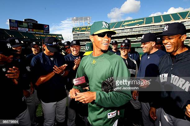 Edwar Ramirez of the Oakland Athletics celebrates with his former teammates after receiving his World Series ring from the 2009 season from the New...