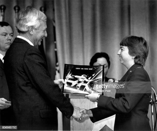 Edward C Aldridge Jr gives a diploma to 2nd Lt Susanne V Lefebvr Credit The Denver Post