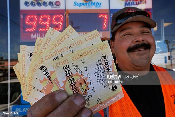SAN PEDRO CA TUESDAY JANUARY 12 2016 Edward Calderon of Wilmington Ca holds twenty dollars worth of Powerball ticekts that he bought at Mr C's Liquor...