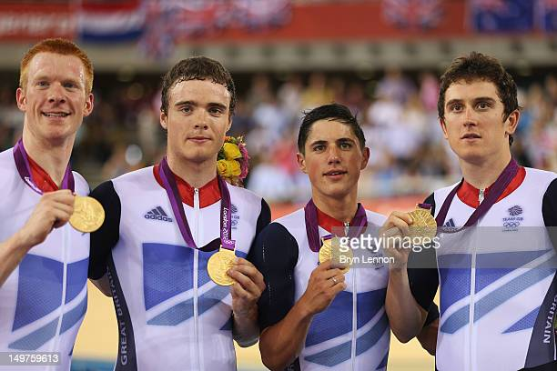 Edward Clancy Steven Burke Peter Kennaugh and Geraint Thomas of Great Britain celebrate with their gold medals during the medal ceremony for the...