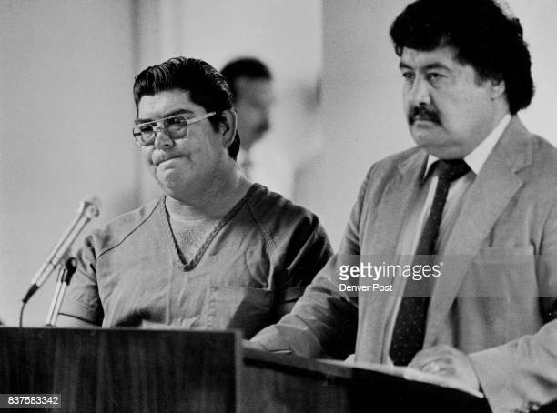 Edward D Quitana and public defender David Cordova listen as charges against Quintana are read in the county court hall of justice in Brighton Credit...