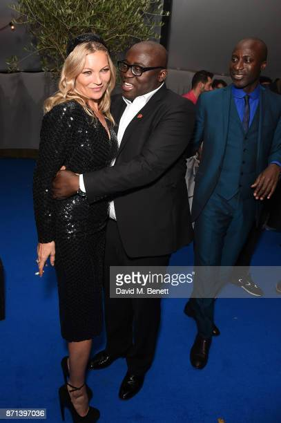 Edward Enninful and Kate Moss with Ozwald Boateng attend a dinner hosted by Jonathan Newhouse and Albert Read for Edward Enninful to celebrate the...