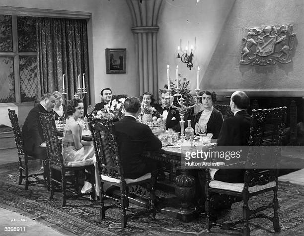 Edward G Robinson Luli Deste Nigel Bruce Ralph Richardson and Constance Collier are among those seated for dinner in the film 'Thunder In The City'...
