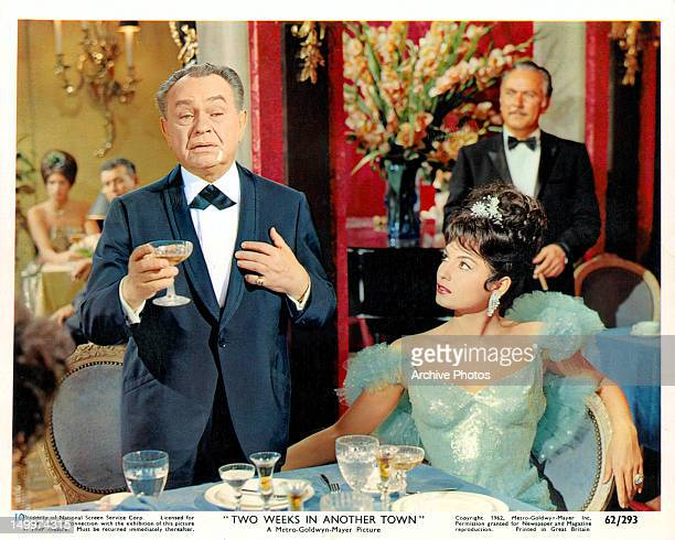 Edward G Robinson making toast as Daliah Lavi watches in a scene from the film 'Two Weeks In Another Town' 1962