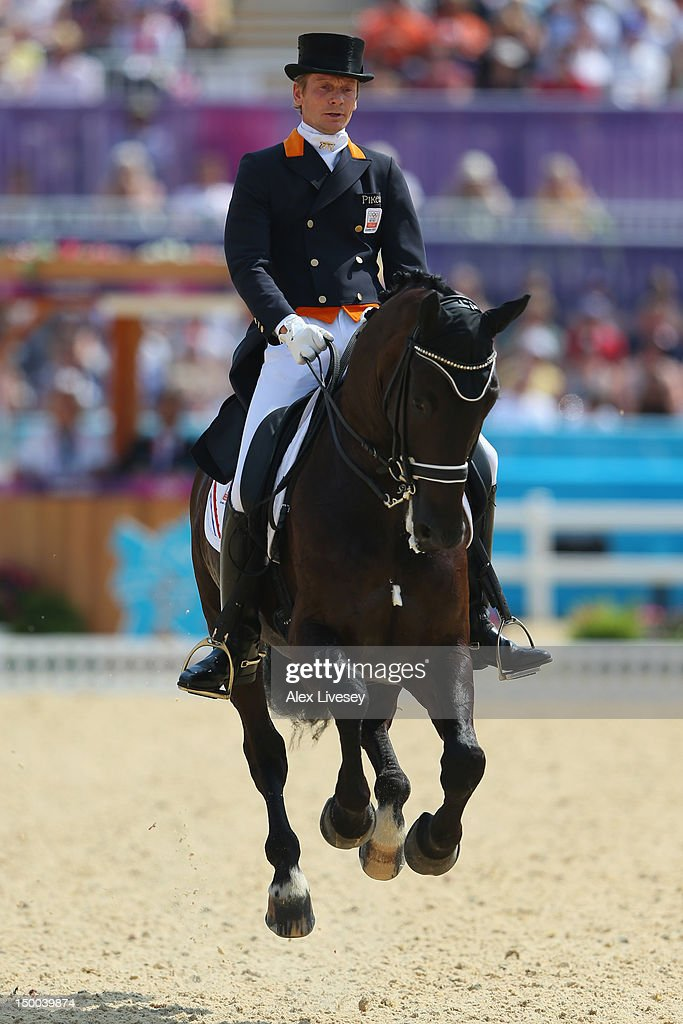 <a gi-track='captionPersonalityLinkClicked' href=/galleries/search?phrase=Edward+Gal&family=editorial&specificpeople=2272233 ng-click='$event.stopPropagation()'>Edward Gal</a> of Netherlands riding Undercover competes in the Individual Dressage on Day 13 of the London 2012 Olympic Games at Greenwich Park on August 9, 2012 in London, England.