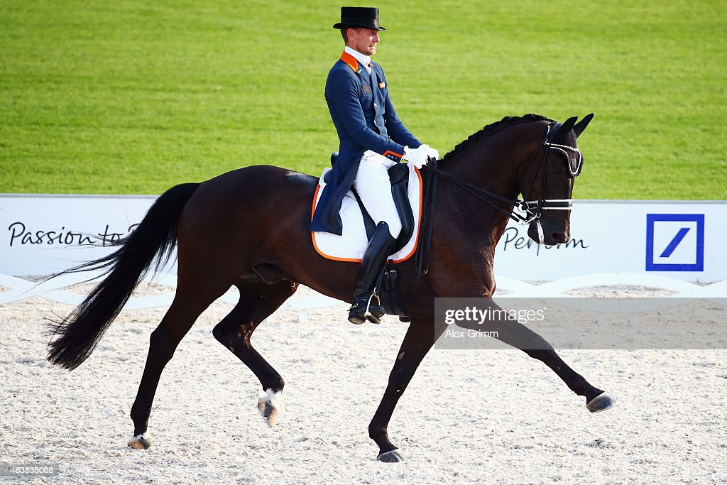 <a gi-track='captionPersonalityLinkClicked' href=/galleries/search?phrase=Edward+Gal&family=editorial&specificpeople=2272233 ng-click='$event.stopPropagation()'>Edward Gal</a> of the Netherlands competes on his horse Glock's Undercover N.O.P. in the Dressage Grand Prix team final and individual qualifier competition during Day 2 of the FEI European Equestrian Championship 2015 on August 13, 2015 in Aachen, Germany.