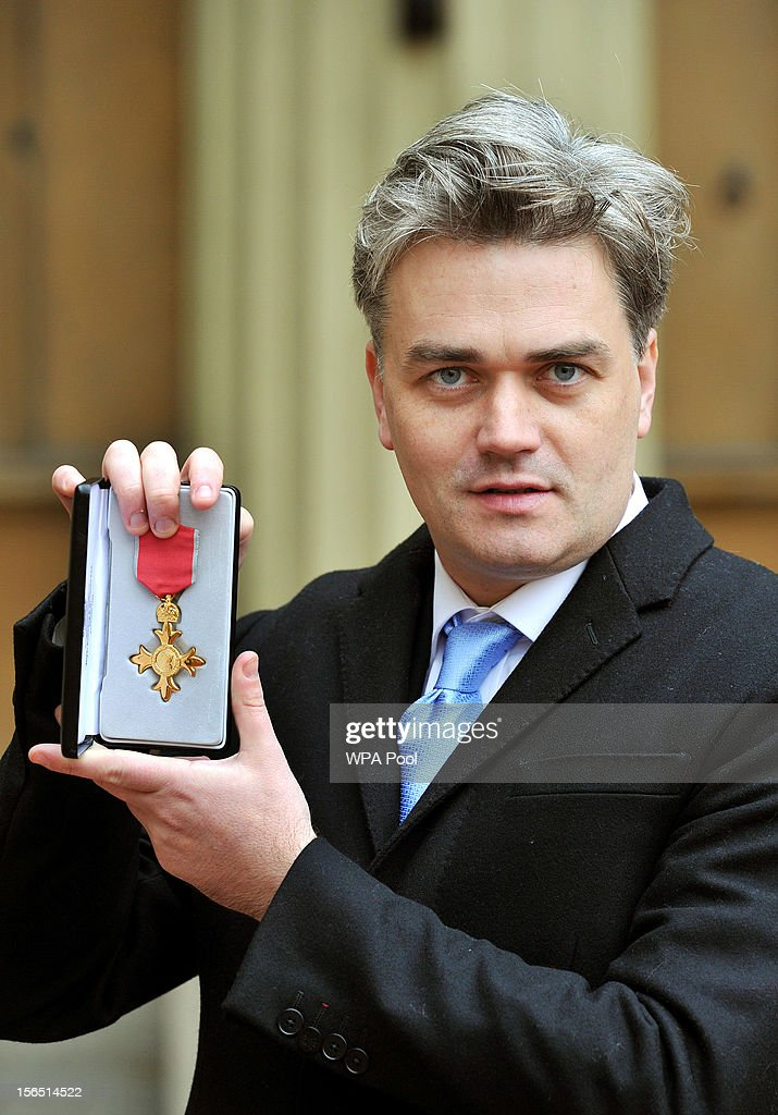Edward Gardner of the English National Opera proudly holds his Officer of the British Empire (OBE) medal, after it was presented to her by Queen Elizabeth II, at the Investiture ceremony at Buckingham Palace on November 16, 2012 in London, England.