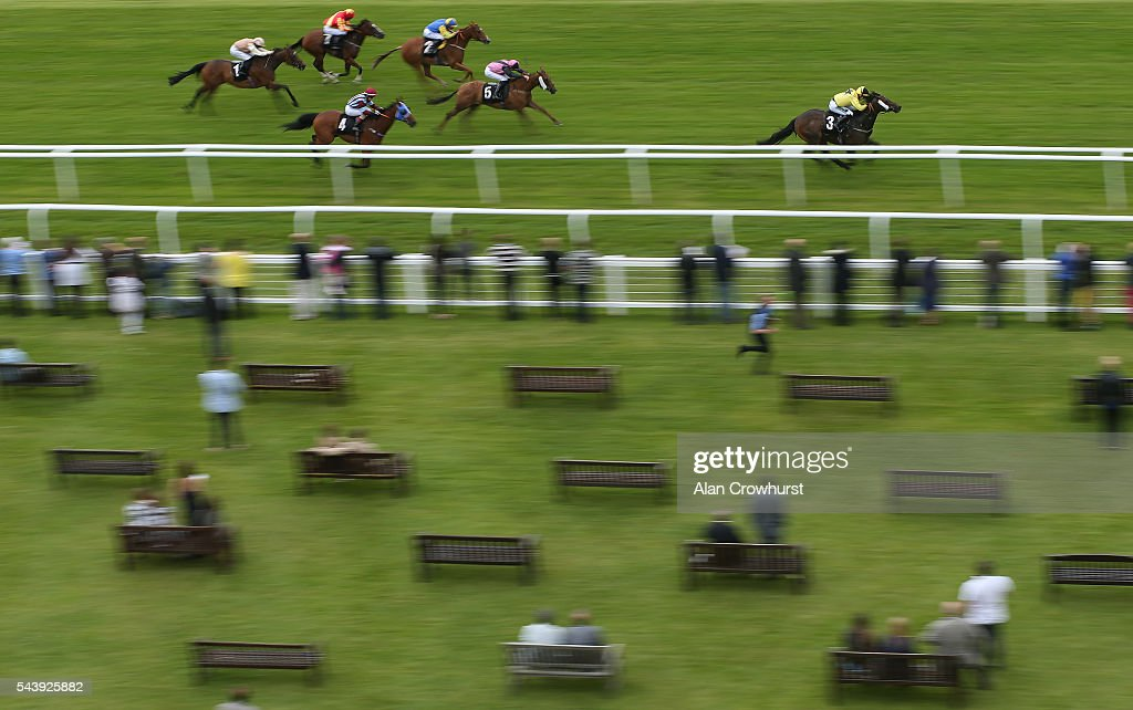 Edward Greatrex riding Quickaswecan win The Donnington Grove Hotel & Fairfield Residential Apprentice Handicap at Newbury racecourse on June 30, 2016 in Newbury, England.