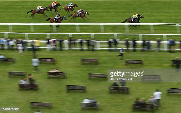 Edward Greatrex riding Quickaswecan win The Donnington Grove Hotel Fairfield Residential Apprentice Handicap at Newbury racecourse on June 30 2016 in...