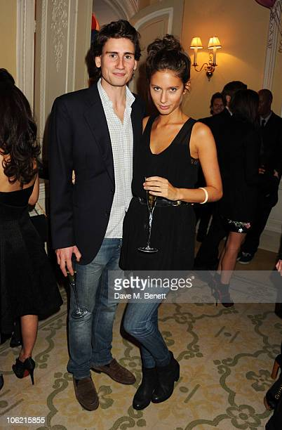Edward Holcroft and Jemima Jones attend a launch party for Vanity Fair's 'On Couture' hosted by Kate Reardon and Michael Roberts at Moet and Chandon...
