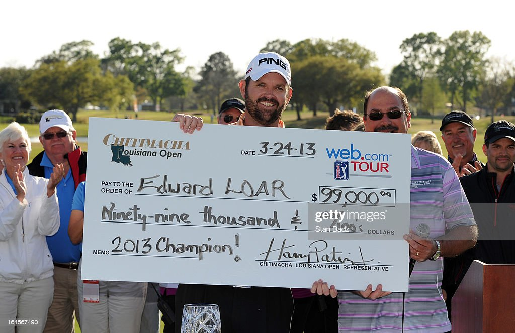 Edward Loar holds the winner's check during the closing ceremony after the final round of the Chitimacha Louisiana Open at Le Triomphe Country Club on March 24, 2013 in Broussard, Louisiana.