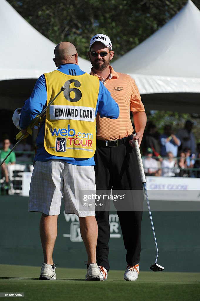 Edward Loar is congratulated by his caddie after winning the Chitimacha Louisiana Open at Le Triomphe Country Club on March 24, 2013 in Broussard, Louisiana.
