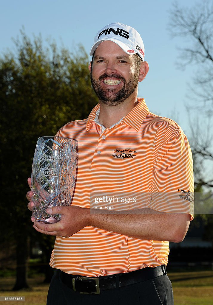 Edward Loar poses with the winner's trophy after final round of the Chitimacha Louisiana Open at Le Triomphe Country Club on March 24, 2013 in Broussard, Louisiana.