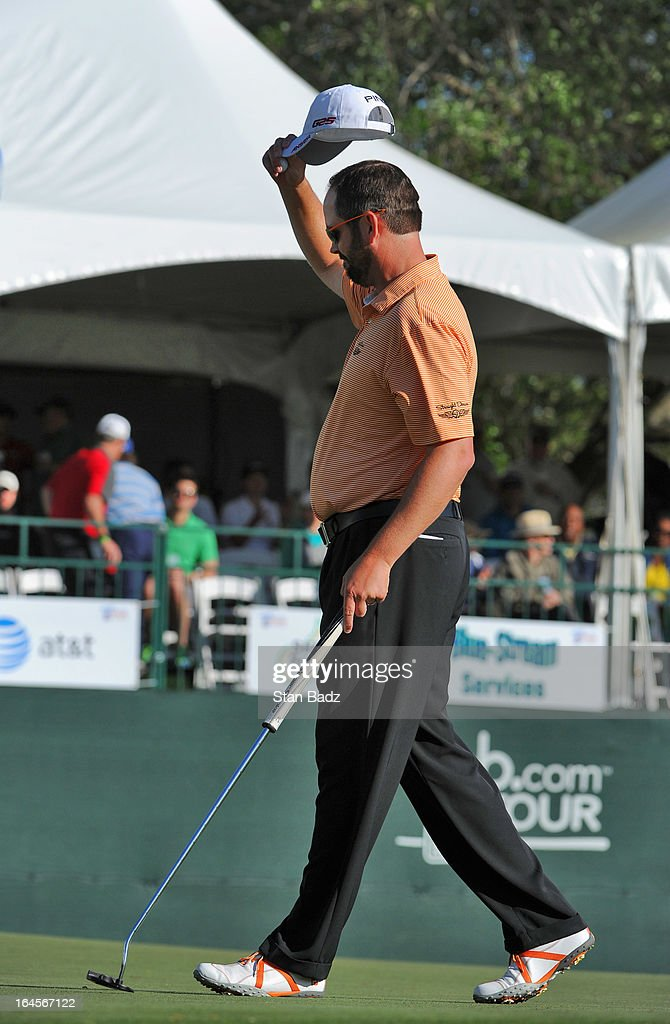 Edward Loar tips his cap to the 18th gallery after winning the final round of the Chitimacha Louisiana Open at Le Triomphe Country Club on March 24, 2013 in Broussard, Louisiana.