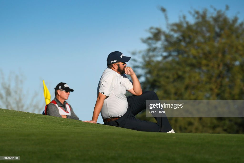 Edward Loar waits for fellow players to finish putting on the eighth green during the first round of the Web.com Tour Qualifying Tournament at Whirlwind Golf Club on the Devils Claw course on December 7, 2017 in Chandler, Arizona.