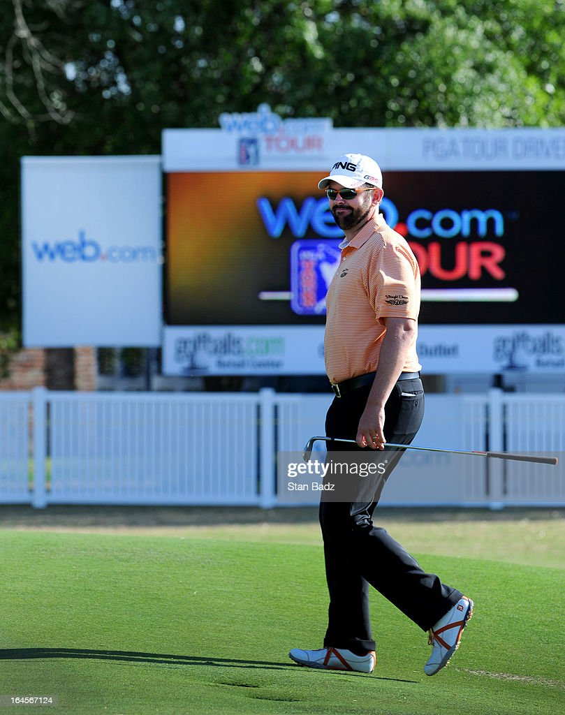 Edward Loar walks to the 18th green during the final round of the Chitimacha Louisiana Open at Le Triomphe Country Club on March 24, 2013 in Broussard, Louisiana.