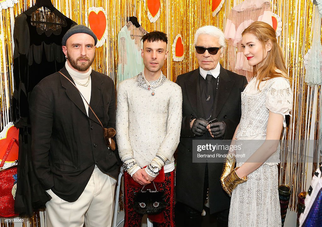Edward Meadham and Benjamin Kirchhoff designers of Meadham Kirchhoff, Karl Lagerfeld and a model attend LVMH Prize Semi-Finalists Designers Cocktail Party on February 26, 2014 in Paris, France.