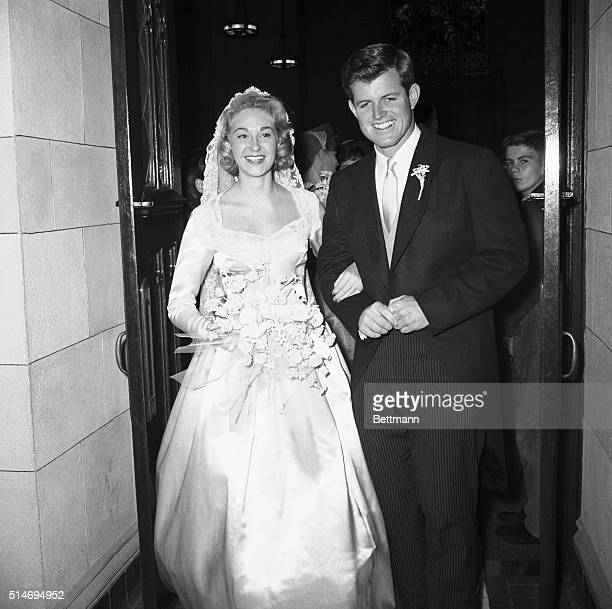 Edward Moore Kennedy son of former US Ambassador to Britain Joseph P Kennedy smilingly poses with his bride postdebutante Joan Bennett after their...