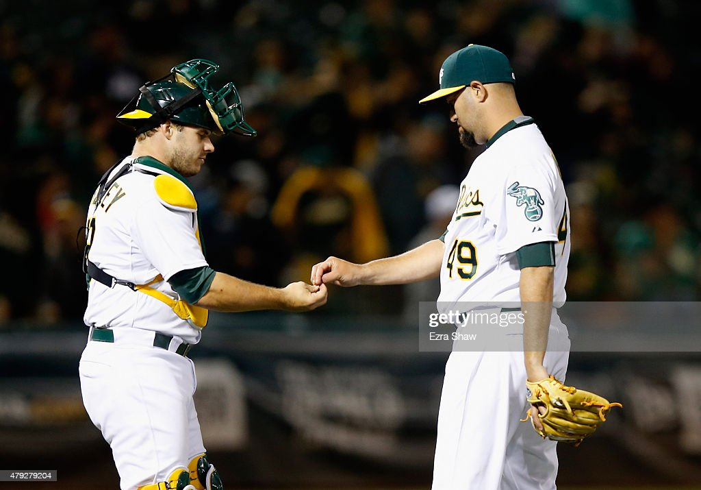 Edward Mujica and Josh Phegley of the Oakland Athletics congratulate one another after they beat the Seattle Mariners at Oco Coliseum on July 2 2015...
