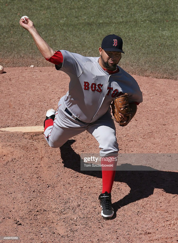 Edward Mujica of the Boston Red Sox delivers a pitch in the eighth inning during MLB game action against the Toronto Blue Jays on July 24 2014 at...