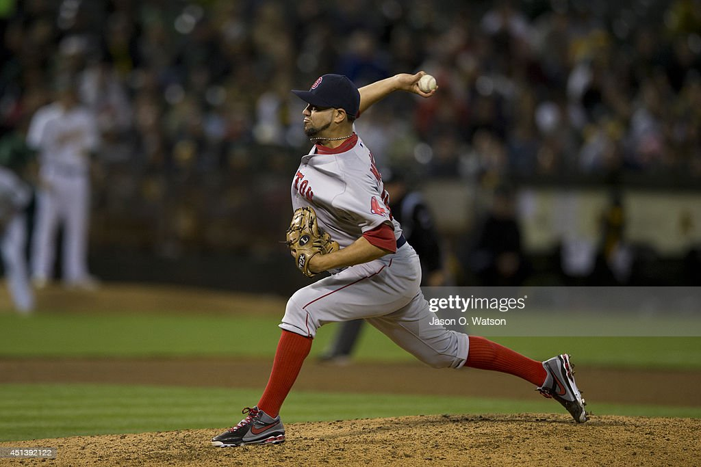 Edward Mujica of the Boston Red Sox pitches against the Oakland Athletics during the eighth inning at Oco Coliseum on June 19 2014 in Oakland...