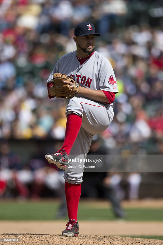 Edward Mujica of the Boston Red Sox pitches against the Oakland Athletics during the tenth inning at Oco Coliseum on June 21 2014 in Oakland...