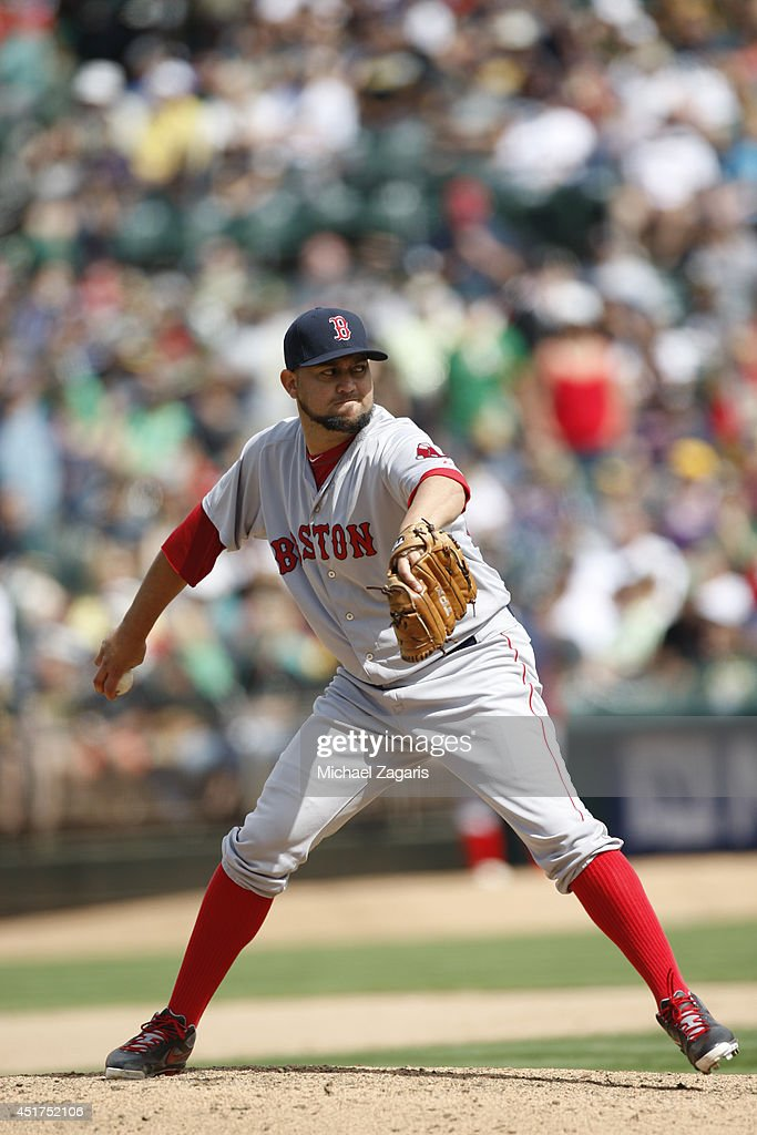 Edward Mujica of the Boston Red Sox pitches during the game against the Oakland Athletics at Oco Coliseum on June 21 2014 in Oakland California The...