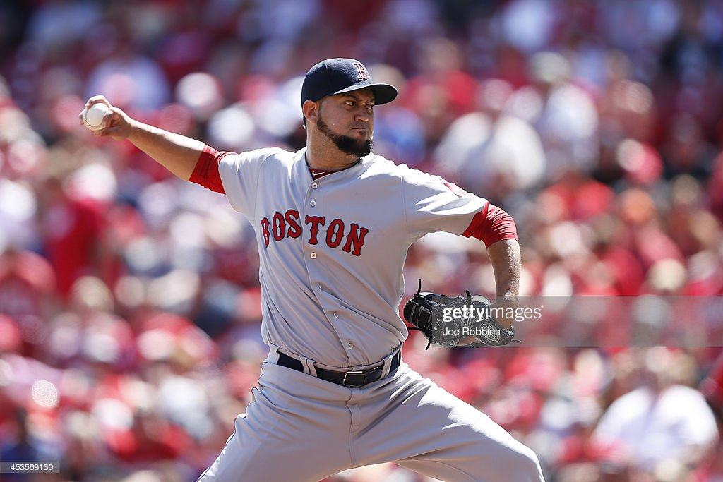 Edward Mujica of the Boston Red Sox pitches in the ninth inning of the game against the Cincinnati Reds at Great American Ball Park on August 13 2014...