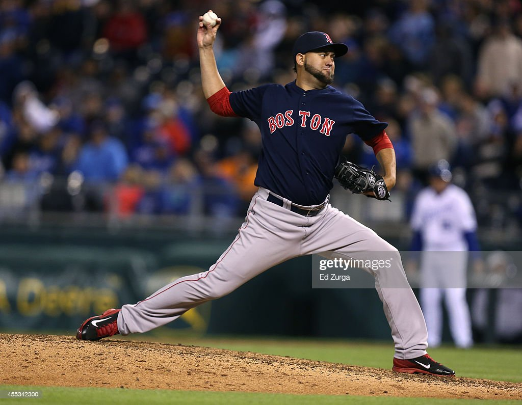 Edward Mujica of the Boston Red Sox throws in the ninth inning against the Kansas City Royals at Kauffman Stadium on September 12 2014 in Kansas City...