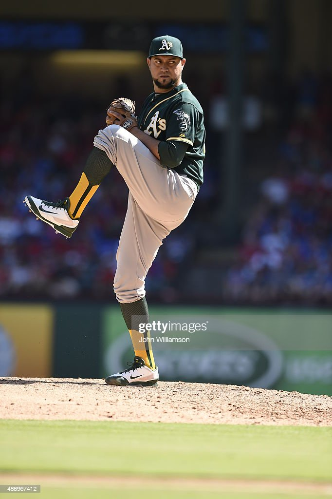 Edward Mujica of the Oakland Athletics pitches against the Texas Rangers at Globe Life Park in Arlington on September 13 2015 in Arlington Texas The...
