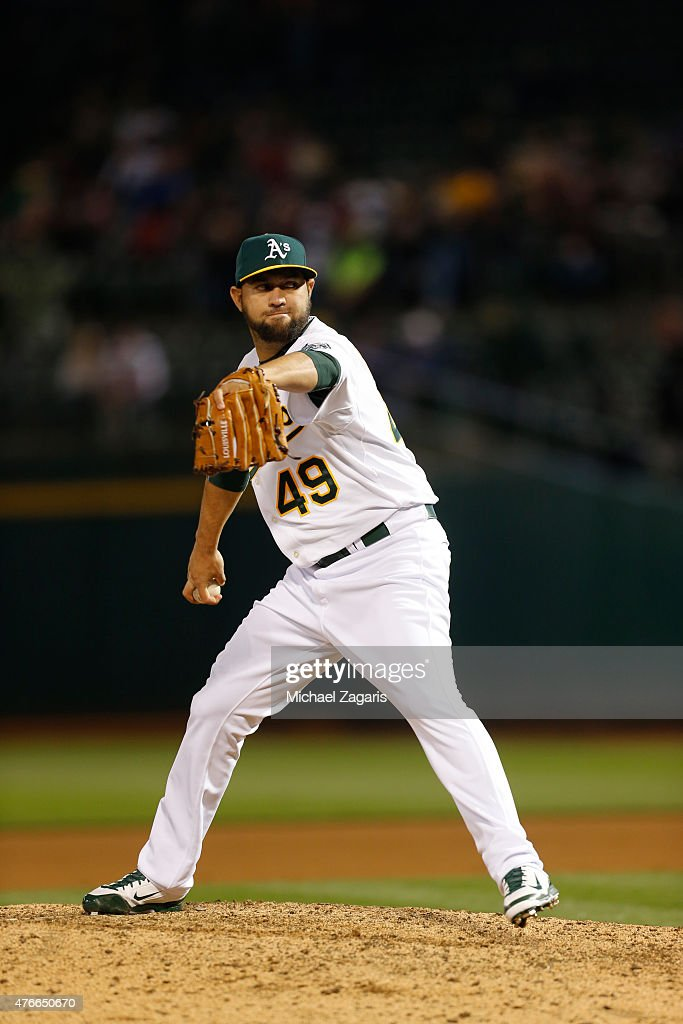 Edward Mujica of the Oakland Athletics pitches during the game against the Boston Red Sox at Oco Coliseum on May 11 2015 in Oakland California The...
