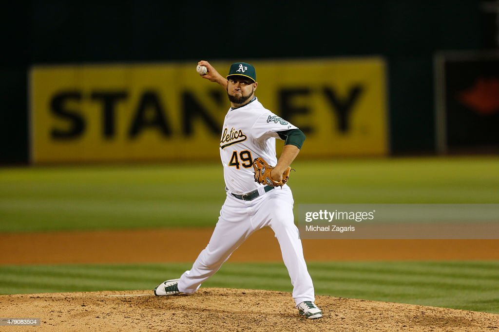 Edward Mujica of the Oakland Athletics pitches during the game against the Los Angeles Angels of Anaheim at Oco Coliseum on June 19 2015 in Oakland...