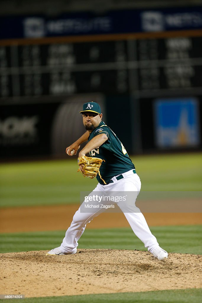 Edward Mujica of the Oakland Athletics pitches during the game against the Colorado Rockies at Oco Coliseum on June 30 2015 in Oakland California The...