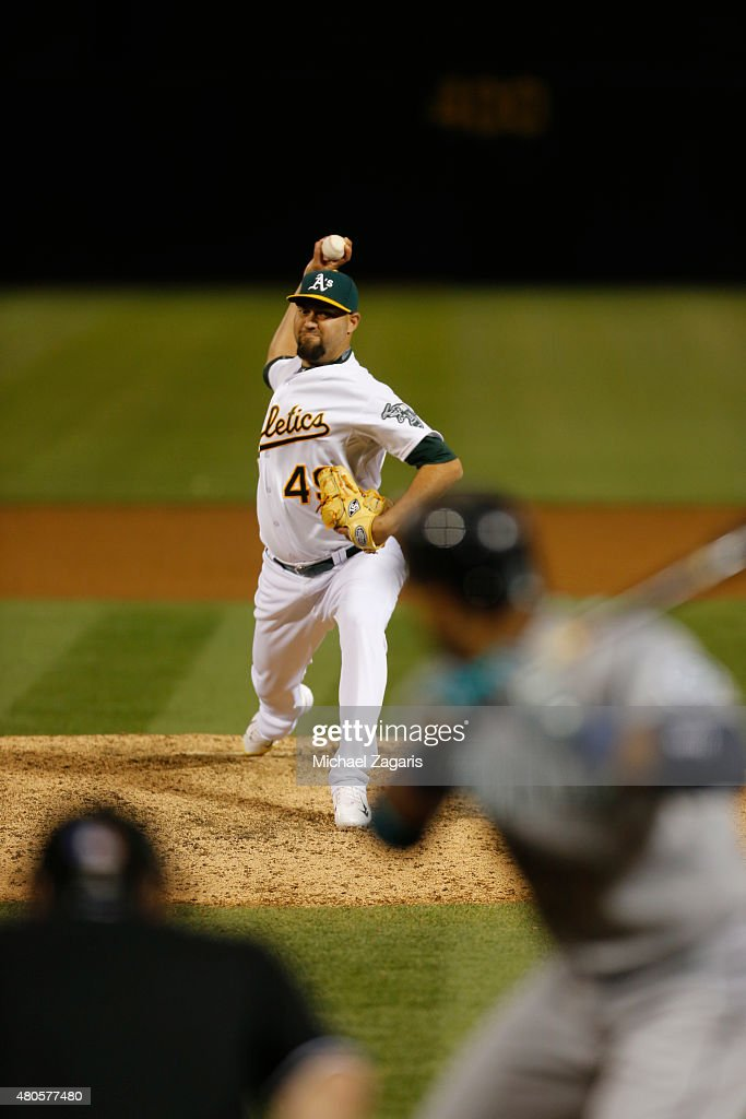 Edward Mujica of the Oakland Athletics pitches during the game against the Seattle Mariners at Oco Coliseum on July 2 2015 in Oakland California The...