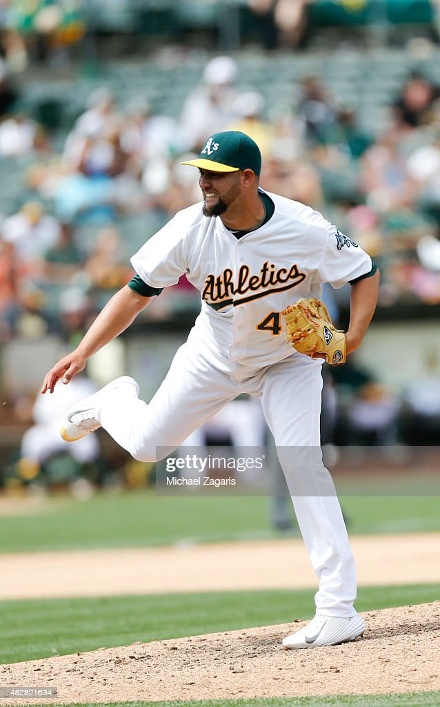 Edward Mujica of the Oakland Athletics pitches during the game against the Minnesota Twins at Oco Coliseum on July 19 2015 in Oakland California The...
