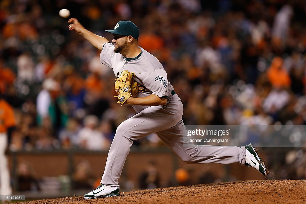 Edward Mujica of the Oakland Athletics pitches in the eighth inning against the San Francisco Giants at ATT Park on July 24 2015 in San Francisco...