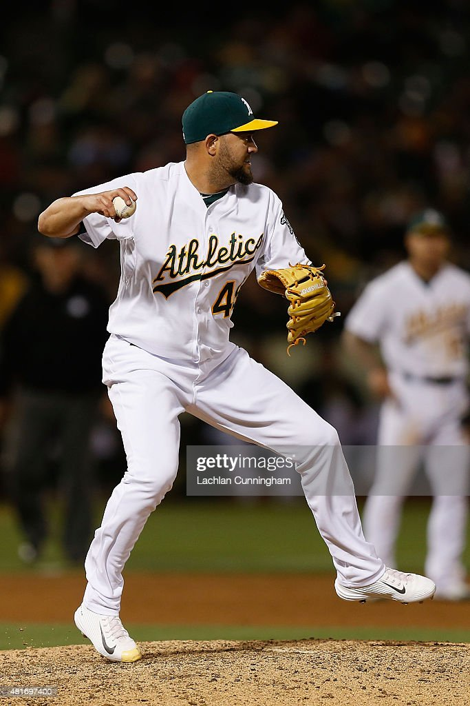 Edward Mujica of the Oakland Athletics throws to second base in an attempted pickoff in the eighth inning against the Toronto Blue Jays at Oco...
