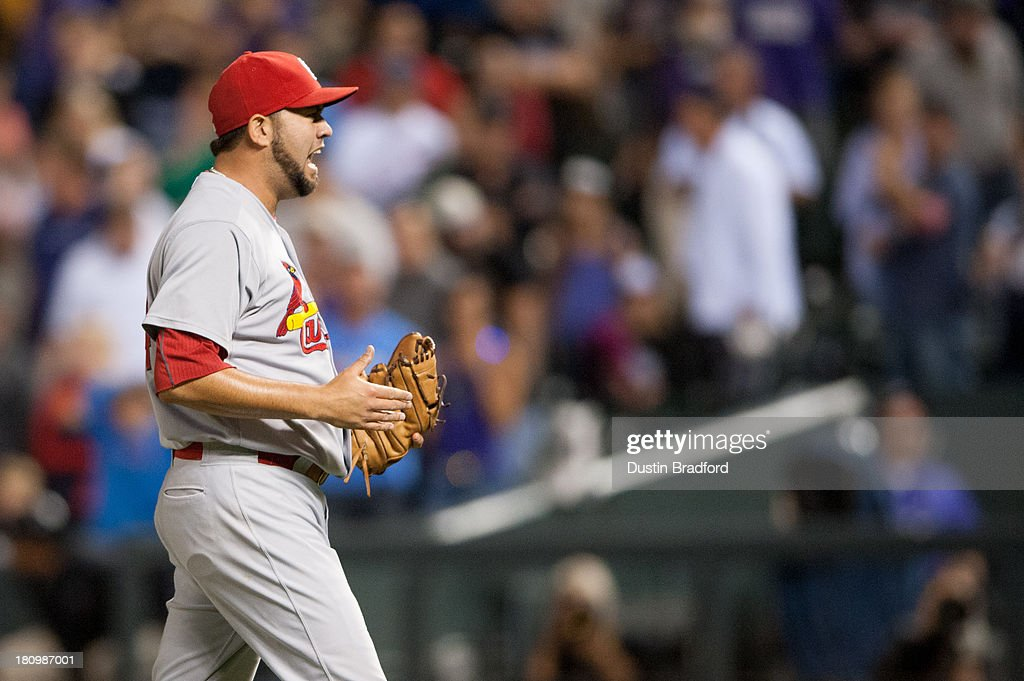 Edward Mujica of the St Louis Cardinals celebrates the win after closing out the ninth inning against the Colorado Rockies during a game at Coors...