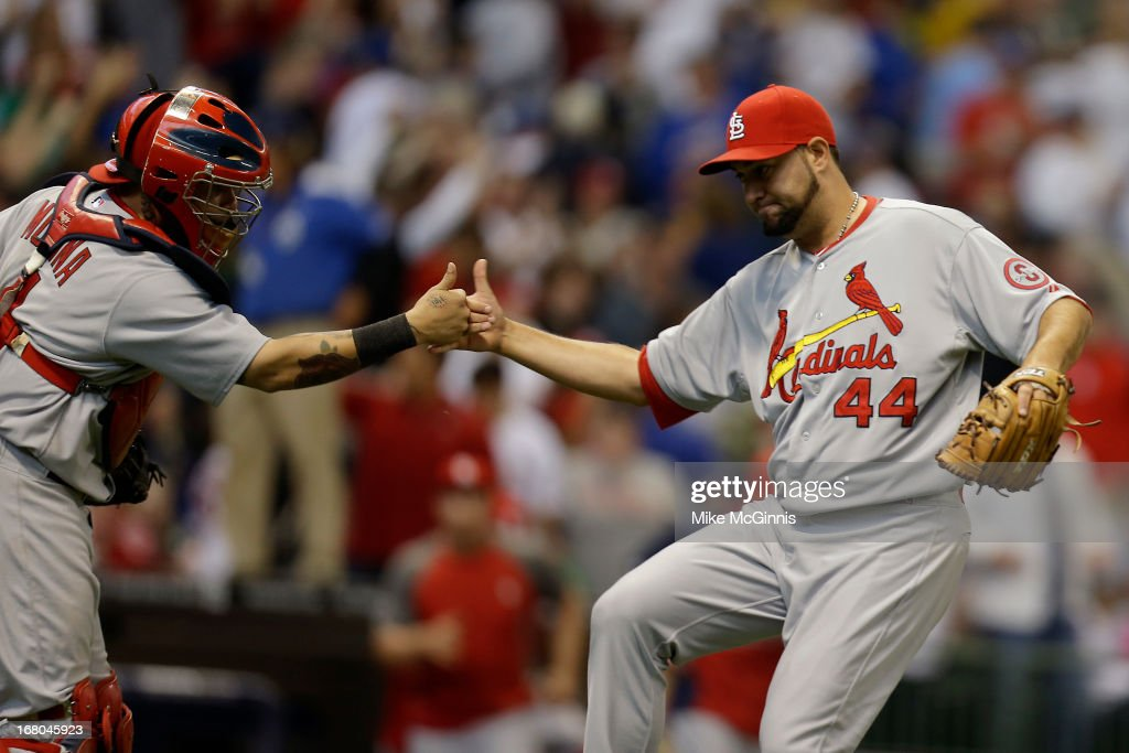 <a gi-track='captionPersonalityLinkClicked' href=/galleries/search?phrase=Edward+Mujica&family=editorial&specificpeople=836179 ng-click='$event.stopPropagation()'>Edward Mujica</a> #44 of the St. Louis Cardinals celebrates with <a gi-track='captionPersonalityLinkClicked' href=/galleries/search?phrase=Yadier+Molina&family=editorial&specificpeople=172002 ng-click='$event.stopPropagation()'>Yadier Molina</a> #4 after the 7-6 win over the Milwaukee Brewers at Miller Park on May 04, 2013 in Milwaukee, Wisconsin.