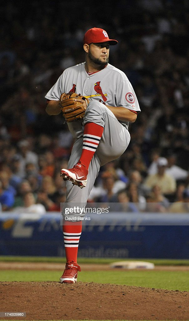Edward Mujica of the St Louis Cardinals pitches against the Chicago Cubs on July 14 2013 at Wrigley Field in Chicago Illinois