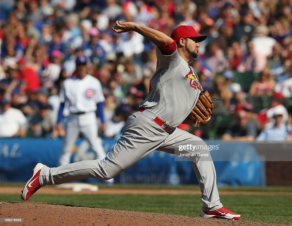 <a gi-track='captionPersonalityLinkClicked' href=/galleries/search?phrase=Edward+Mujica&family=editorial&specificpeople=836179 ng-click='$event.stopPropagation()'>Edward Mujica</a> #44 of the St. Louis Cardinals pitches for a save in the 9th inning against the Chicago Cubs at Wrigley Field on May 8, 2013 in Chicago, Illinois. The Cardinals defeated the Cubs 5-4.