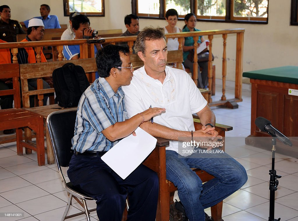 Edward Norman Myatt (R) of Australia attends his trial at a court in Denpasar on Bali island on July 11, 2012. Indonesian prosecutors have recommended a 15-year prison sentence for Myatt, who was arrested last February with 1.1 kg of hashish and seven grams of methamphetamine after allegedly attempting to smuggle them into the Indonesian resort island of Bali.